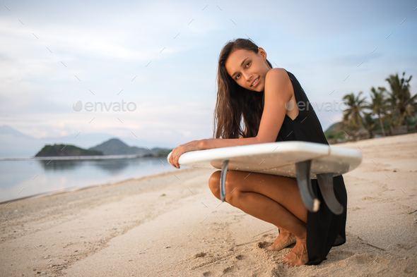 cute sporty surfer girl or smiling happy brunette woman - Stock Photo - Images