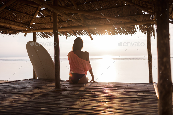 sexy handsome girl or sporty woman watching sunset - Stock Photo - Images
