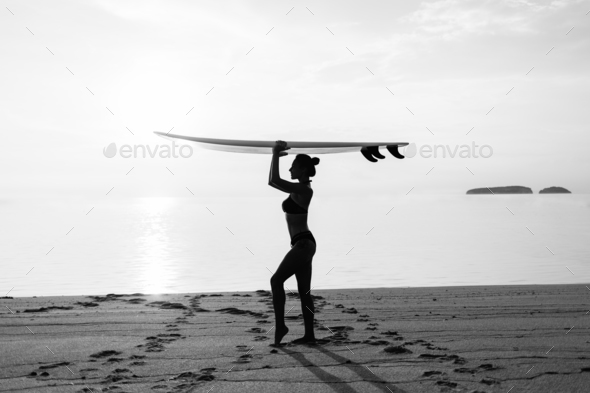 black and white silhouette of fit girl on the beach - Stock Photo - Images