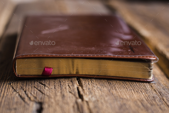 Notebook on wooden background - Stock Photo - Images