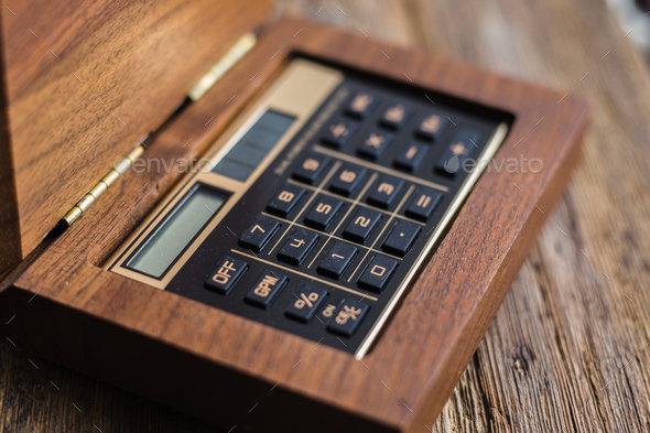 Calculator closeup on wooden background - Stock Photo - Images