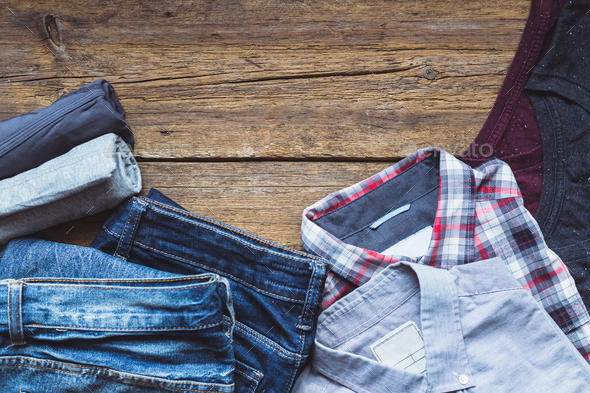 Clothes on an old wooden background - Stock Photo - Images