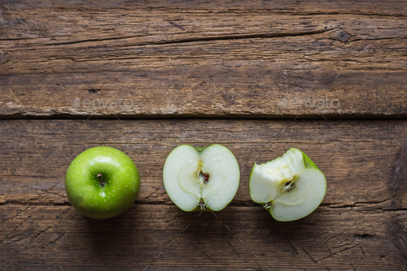 Ripe green apples on wooden background - Stock Photo - Images