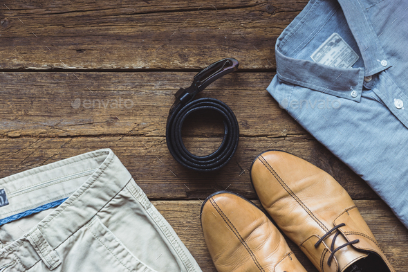 Men's clothes and accessories on wooden background. Top view - Stock Photo - Images