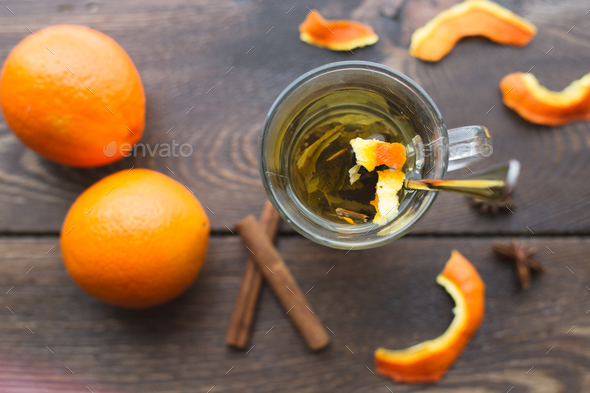 A cup of tea with oranges and cinnamon - Stock Photo - Images