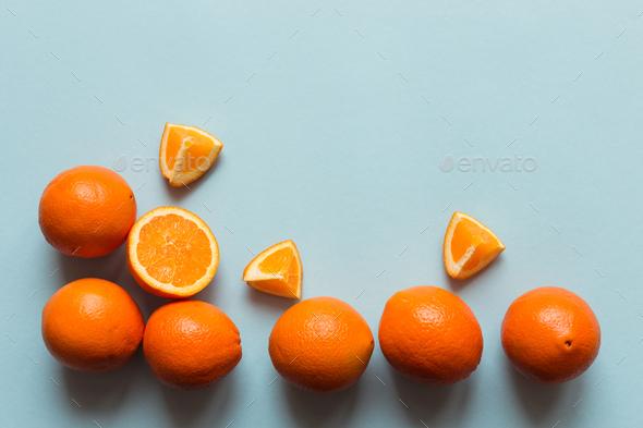 Fresh oranges on the blue background - Stock Photo - Images