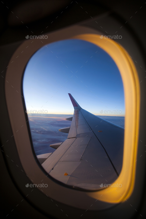 Morning sunrise with Wing of an airplane. - Stock Photo - Images
