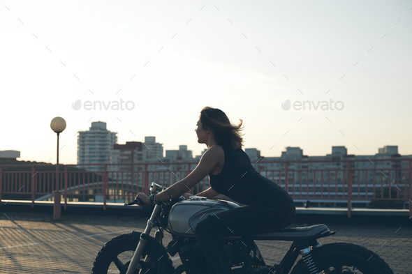 Biker Woman on motorcycle - Stock Photo - Images