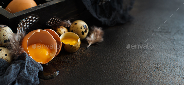 Сhicken and quail eggs in a box - Stock Photo - Images
