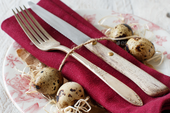 Easter table setting with quail eggs - Stock Photo - Images