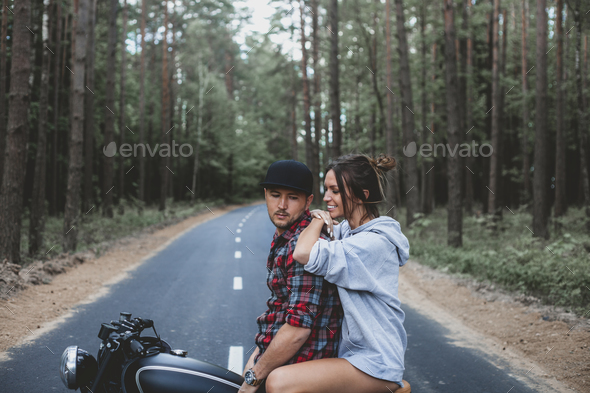 handsome young man and woman travelling together on motorbike - Stock Photo - Images
