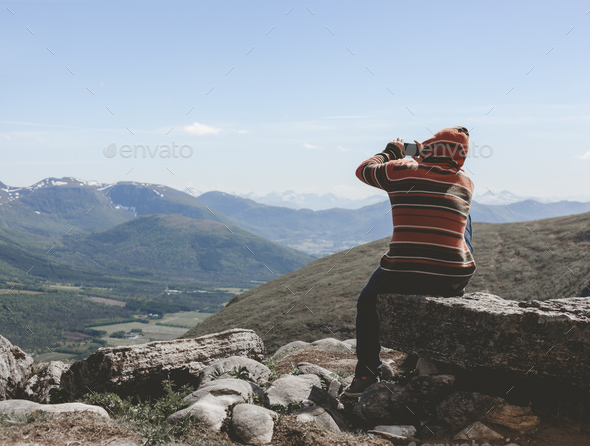 Guy taking pictures of nature - Stock Photo - Images