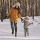 Happy Mother and Daughter Laughing and Jumping in Winter Forest in - VideoHive Item for Sale
