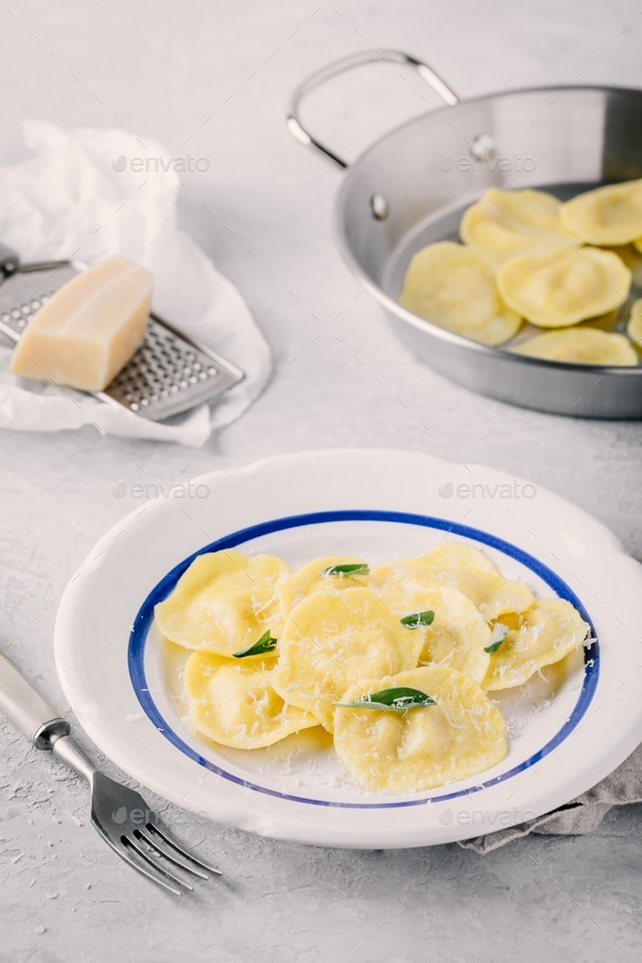 ravioli pasta with parmesan cheese and sage - Stock Photo - Images