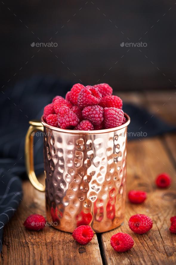 Fresh ripe raspberries in a copper mug - Stock Photo - Images