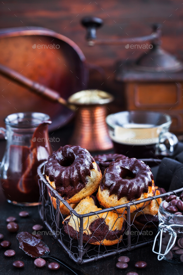Marble mini bundt cakes with chocolate frosting - Stock Photo - Images