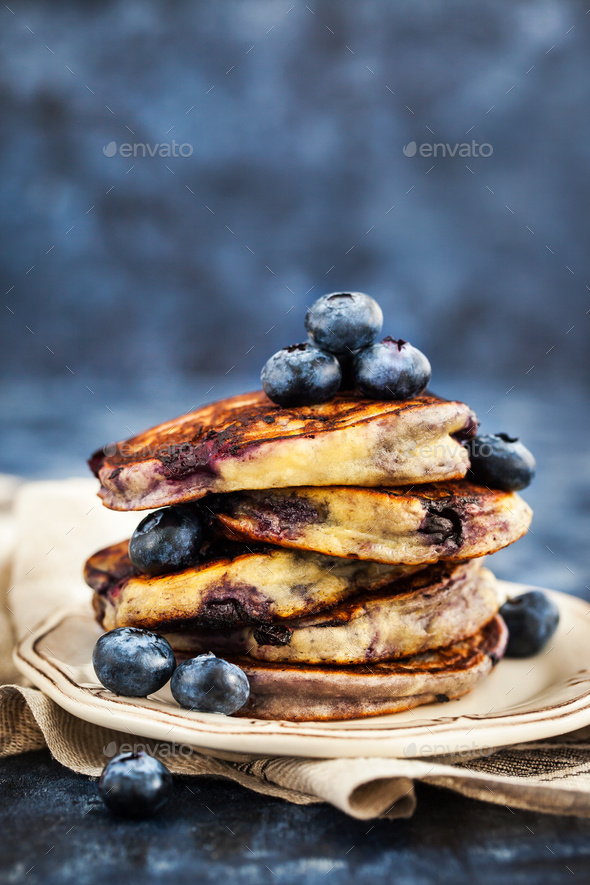 Stack of freshly prepared blueberry ricotta pancakes with fresh - Stock Photo - Images