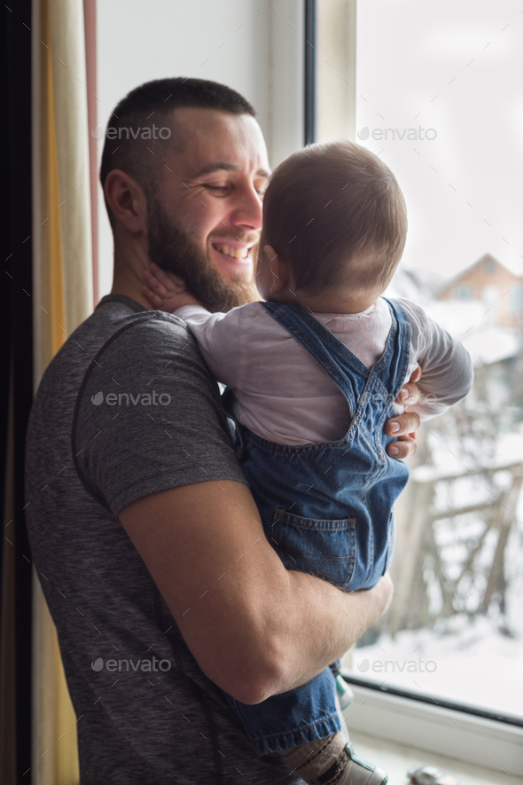 A father holding his son - Stock Photo - Images
