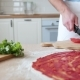 The Man Cuts the Tomatoes for the Pizza - VideoHive Item for Sale