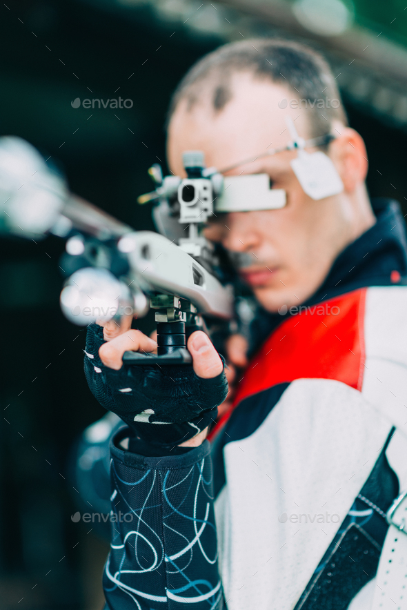 Man practicing for competition sport shooting with free rifle - Stock Photo - Images