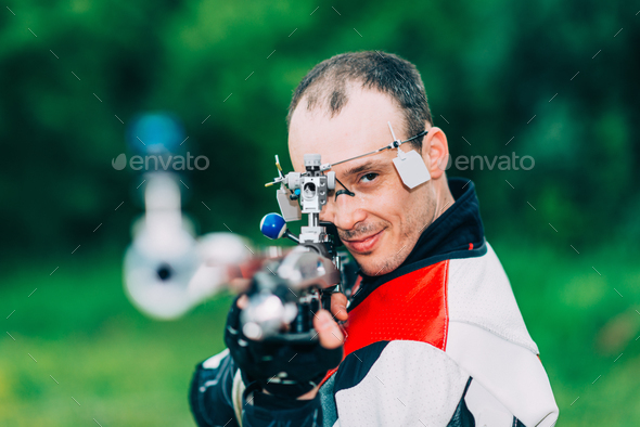 Smiling man on free rifle triaining - Stock Photo - Images