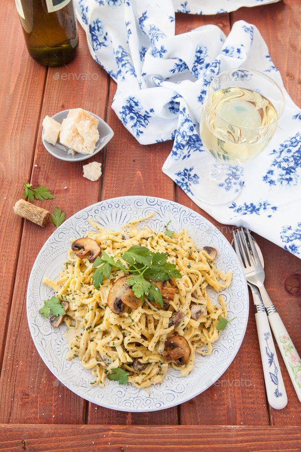 Pasta with a creamy mushroom sauce - Stock Photo - Images