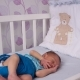 A Newborn Baby Lies in the Crib - VideoHive Item for Sale