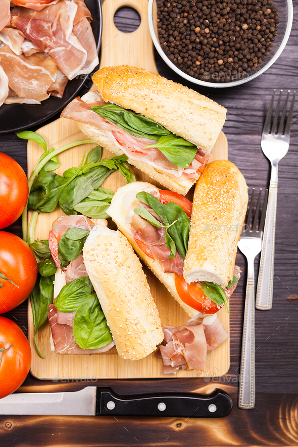 Close up on healthy sandwiches lying on wooden board - Stock Photo - Images
