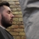 Barber Cuts the Hair of the Client Brunette Man with Barber Tools - VideoHive Item for Sale