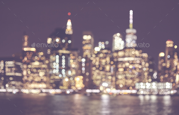 Blurred retro toned picture of Manhattan skyline at night, NYC. - Stock Photo - Images