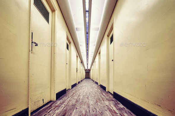 Empty corridor in an old building, color toned picture - Stock Photo - Images