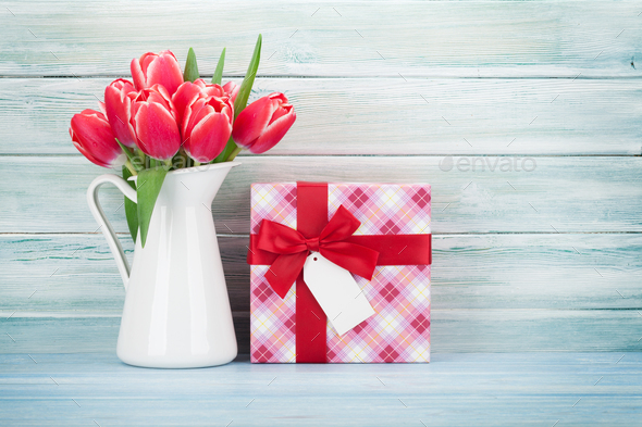 Red tulip flowers and gift box - Stock Photo - Images