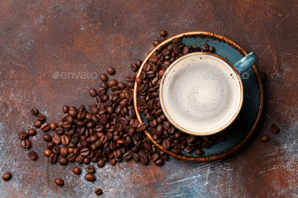 Coffee cup and roasted beans - Stock Photo - Images