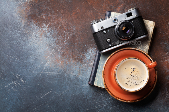 Coffee cup and retro camera - Stock Photo - Images