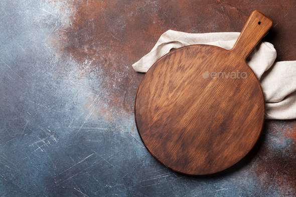Cutting board over metal table - Stock Photo - Images