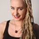 Modern Youth. Portrait of a Cheerful Beautiful Girl of Unusual Appearance - Dreads, Piercings and