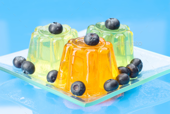 colored gelatins on blue background - Stock Photo - Images