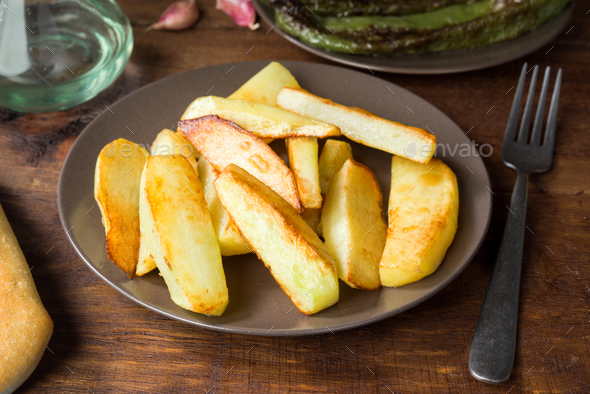 dish of traditional chips on rustic wood - Stock Photo - Images