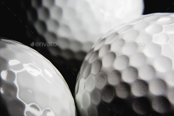 Golf ball on black background - Stock Photo - Images