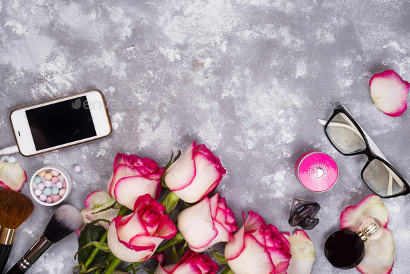 Roses and decorative cosmetics as frame - Stock Photo - Images