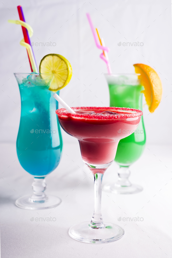 colorful cocktails in glass on white background - Stock Photo - Images