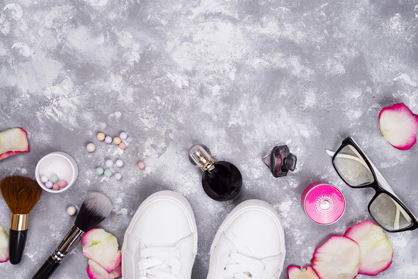 cosmetics in perfume and shoes on a gray background with copy space - Stock Photo - Images