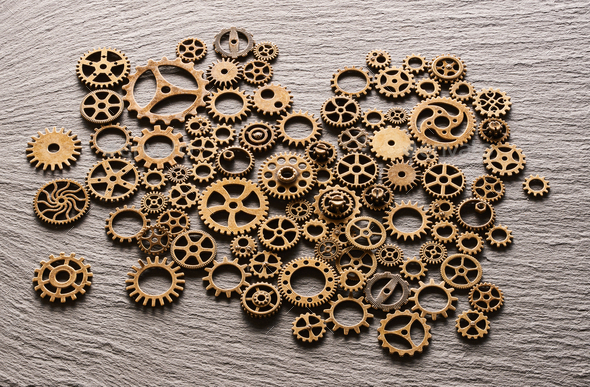 Various metal cogwheels and gear wheels - Stock Photo - Images