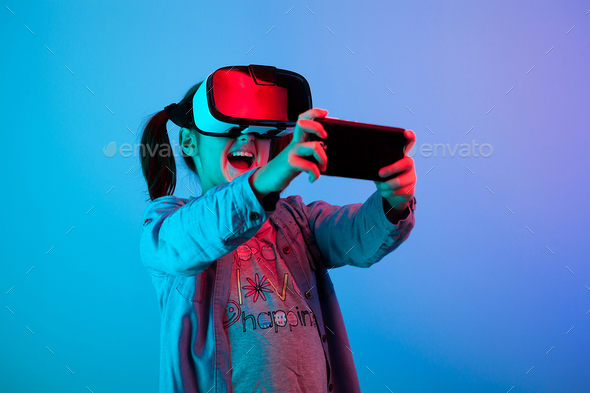 Teenage kid playing with VR virtual reality - Stock Photo - Images