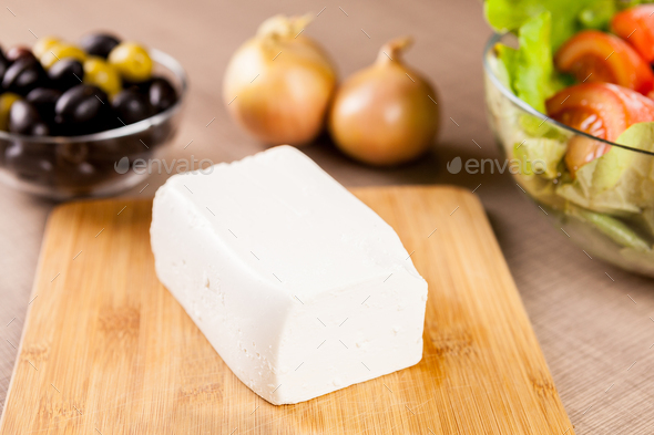 Feta cheese on wooden board - Stock Photo - Images