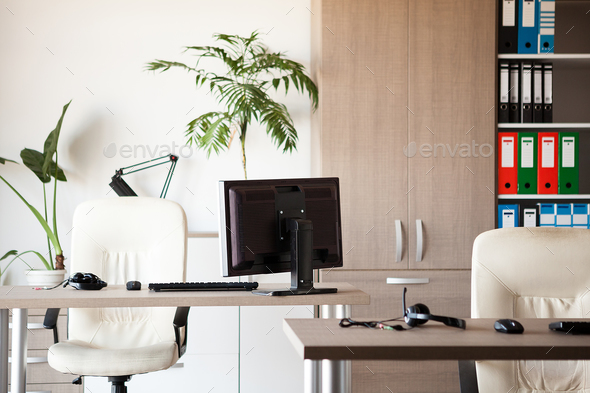 Empty office in the morning when nobody is at work - Stock Photo - Images