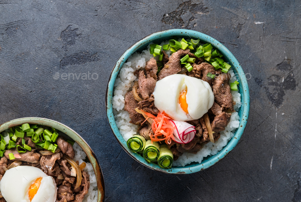 Gyudon - japanese rice and beef bowl on dark background - Stock Photo - Images