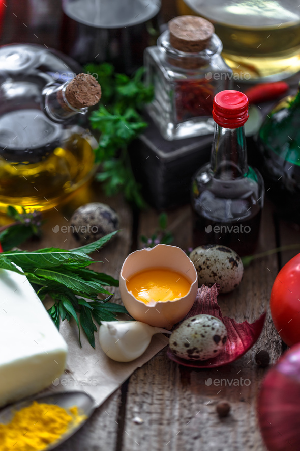 Egg yolk with various cooking ingredient in background - Stock Photo - Images