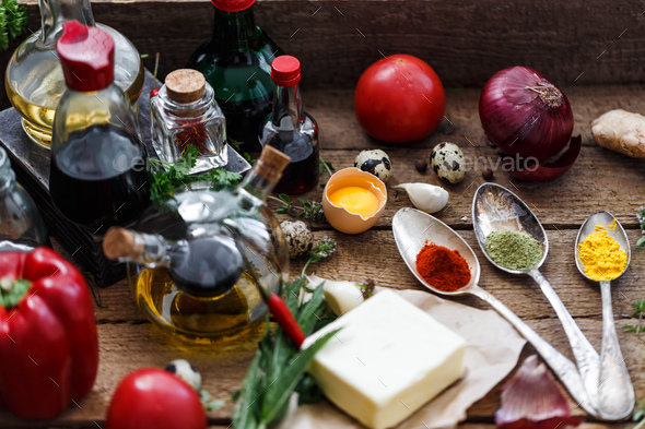 Various spices, oils and sauces selection on wooden background - Stock Photo - Images