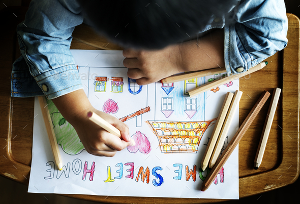 Young boy coloring - Stock Photo - Images